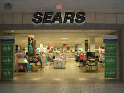 the signage of negative space sears. Black Bedroom Furniture Sets. Home Design Ideas